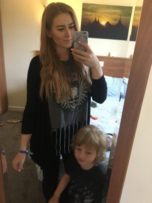mirror selfie of me wearing grey coloured top with skull on and black cardigan with my son standing in front of me