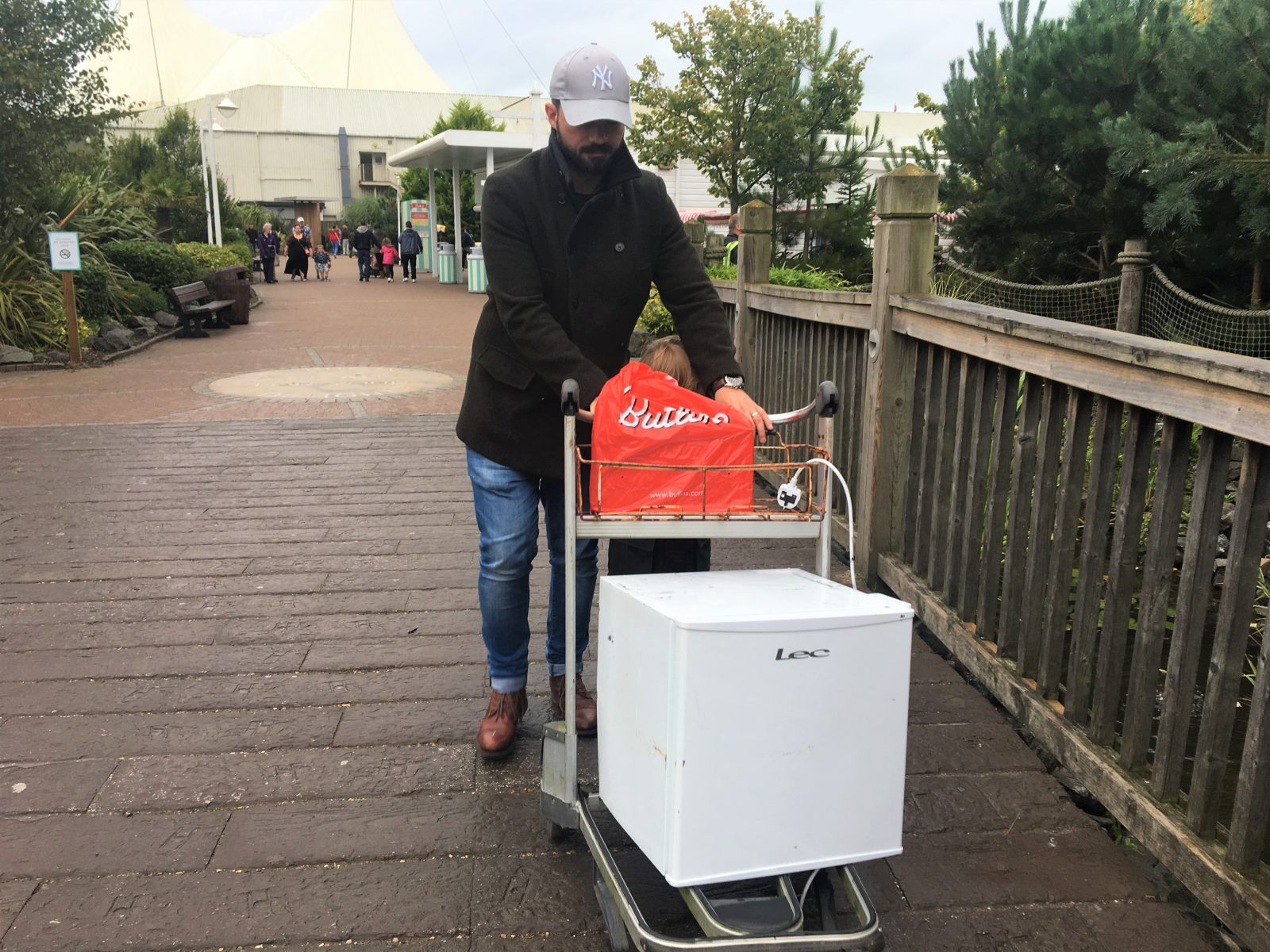 my husband pushing the fridge on a trolley