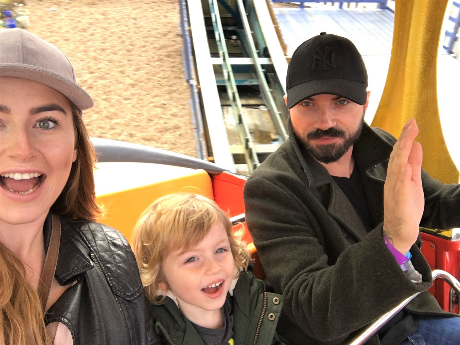 myself, my son and husband taking a selfie on a ride and smiling