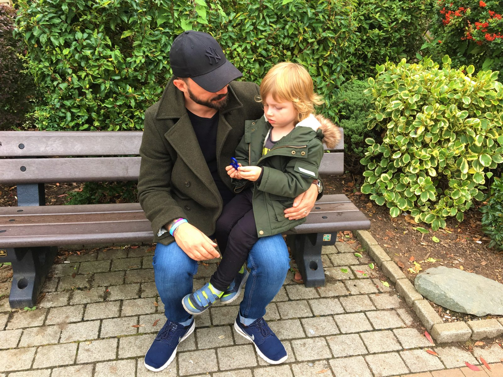 my husband and son sitting on a bench