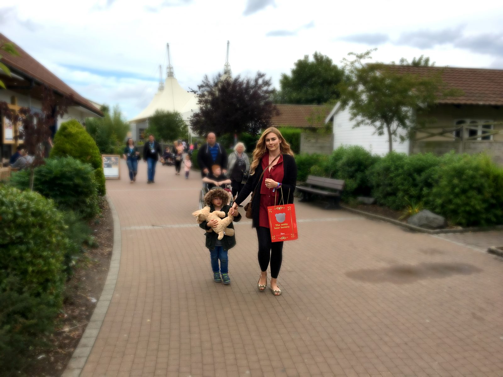me walking with my son and his new teddy with butlins white tent in background