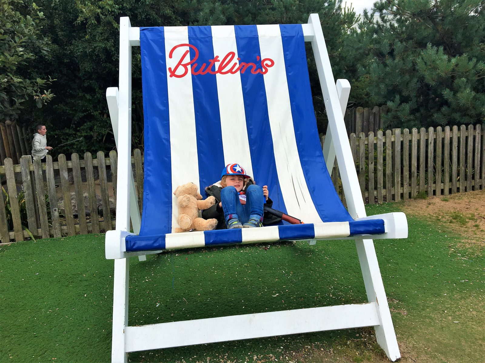 my son sitting in a giant butlins deckchair